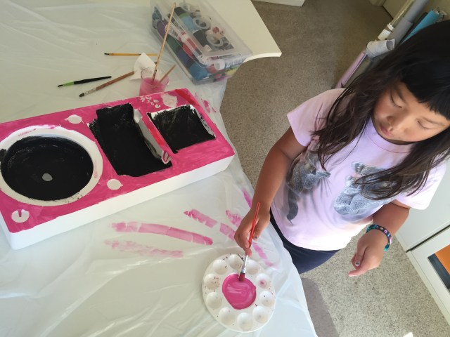 Painting her cool looking speakers