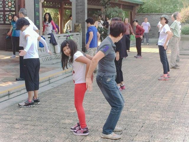 Participating in Por Por and Gung Gung's morning exercise group