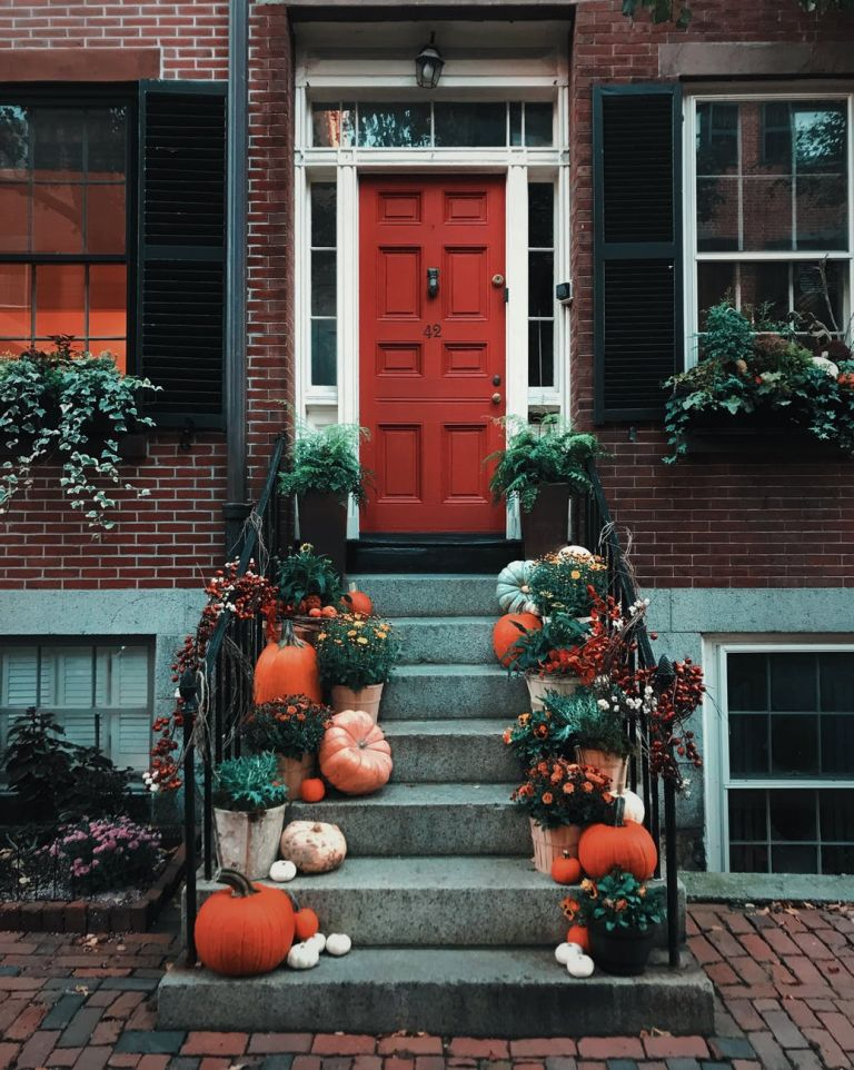 pumpkins on stairs in front of a door