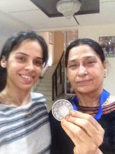 Saina with her mother showing medal