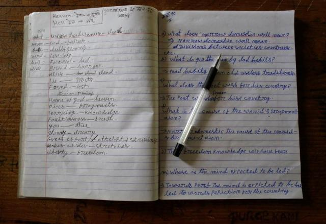 """An English notebook belonging to Durga Kami, 68, who is studying in the tenth grade at Shree Kala Bhairab Higher Secondary School, is seen on his desk in Syangja, Nepal, June 6, 2016. REUTERS/Navesh Chitrakar. SEARCH """"DURGA KAMI"""" FOR THIS STORY. SEARCH """"THE WIDER IMAGE"""" FOR ALL STORIES"""