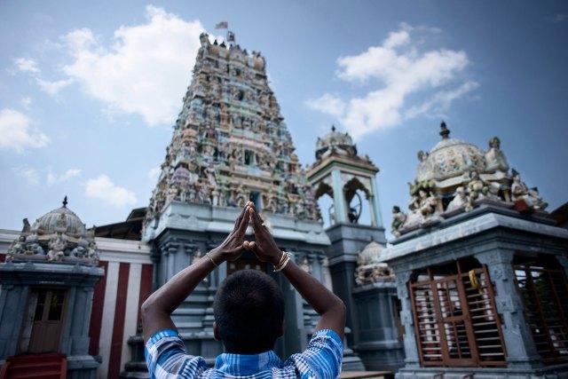 A Tamil devotee prays at a Hindu temple in Mannar district, in Sri Lanka's northwest.