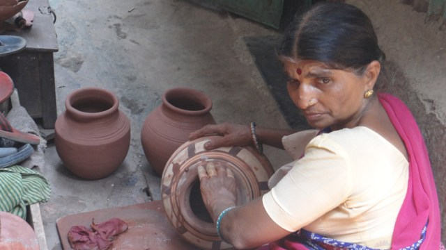 Many artisans work in the slums to support families living in far off villages
