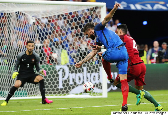 SAINT-DENIS, FRANCE - JULY 10, 2016: Portugal's goalkeeper Rui Patricio (L), Jose Fonte (R) defend against France's Olivier Giroud (C) in their 2016 UEFA European Football Championship final match at Stade de France. Alexander Demianchuk/TASS (Photo by Alexander DemianchukTASS via Getty Images)