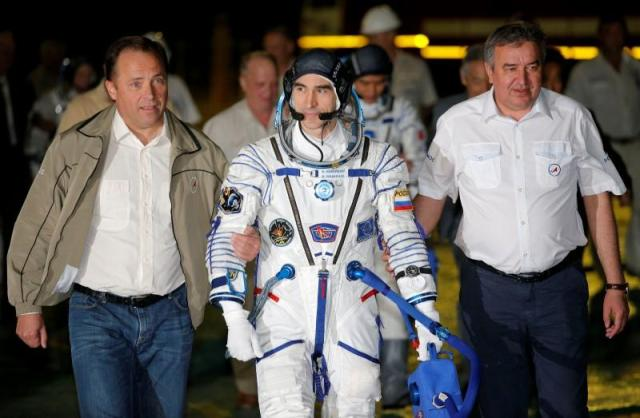 The International Space Station (ISS) crew member Anatoly Ivanishin of Russia walks to the rocket prior the launch at the Baikonur cosmodrome, Kazakhstan, July 7, 2016. REUTERS/Dmitri Lovertsky/POOL?