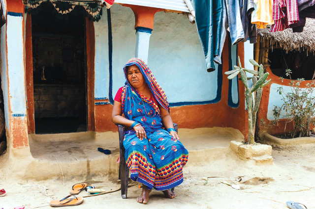 Ujjwal's mother is worried that her family will be asked to vacate their house, which is on government land. Her three sons all work abroad.