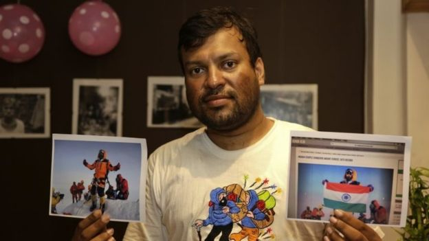 """Satyarup Sidhantha holds the genuine photo in his right hand and the """"doctored"""" photo in his left hand"""