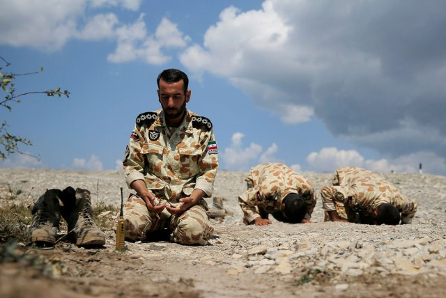 Iranian servicemen pray during the Paratrooper's platoon competition for airborne squads, part of the International Army Games 2016, at the Rayevsky shooting range outside the Black Sea port of Novorossiysk.