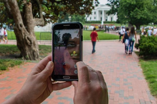 A Pokemon player searches the square in front of the White House