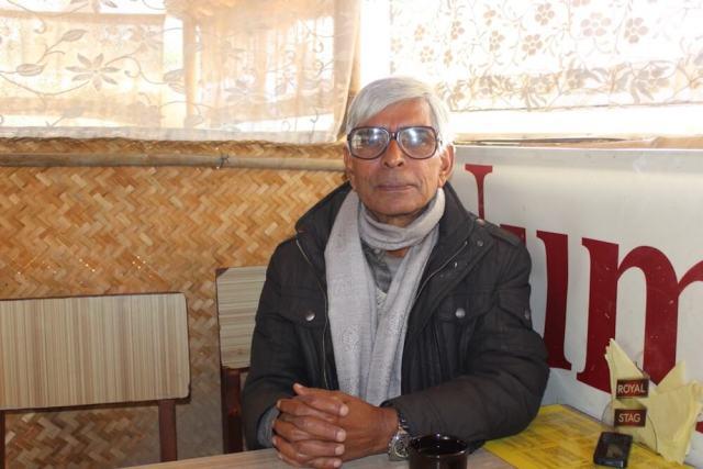 Khagendra Sangroula has translated dozens of communist revolutionary novels into Nepali [Saif Khalid/Al Jazeera]