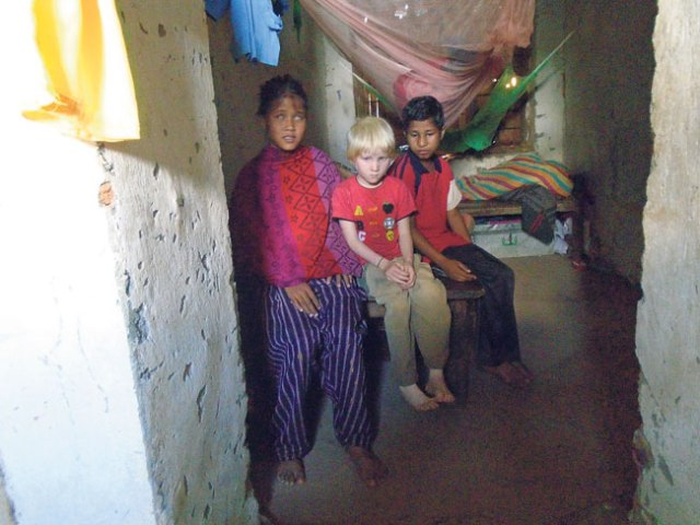 Three students with special needs at their dormitory near a school they attend. (Kalpana)