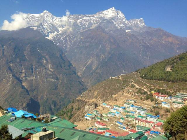 Snowpeaks rising over the rooftops of Namche Bazaar © Anna Kaminski / Lonely Planet