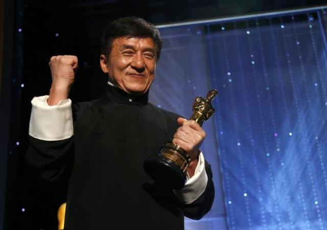 Actor Jackie Chan poses with his Honorary Award at the 8th Annual Governors Awards in Los Angeles, California, U.S.