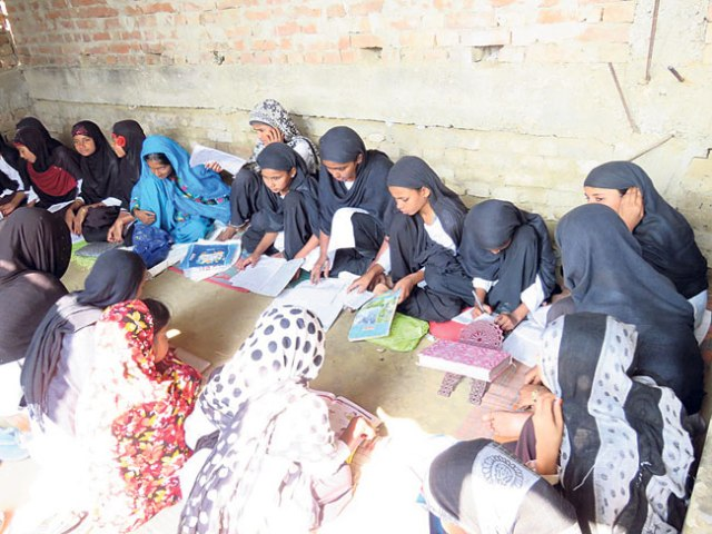 Students studying in a classroom of Jamiya Khadijatul Kubra Muslim Girls School in Farhadwa VDC, Rautahat in this recent picture.