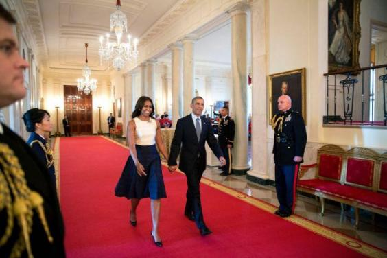 And they're off: the couple walking through the White House