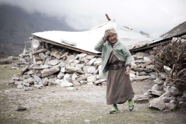 Karchung Tamang's house was once a lodge and restaurant but has gone unrepaired. Delays in reconstruction have been blamed for more than a dozen deaths during the winter, with elderly people bearing the brunt. Karchung now has no job or income and relies on the charity of other local people