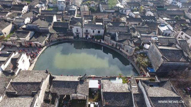 Photo taken on Nov. 26, 2016 shows the scenery of Yuezhao, or Moon Pool, at Hongcun, an ancient village in Yixian County in Huangshan City, east China's Anhui Province.
