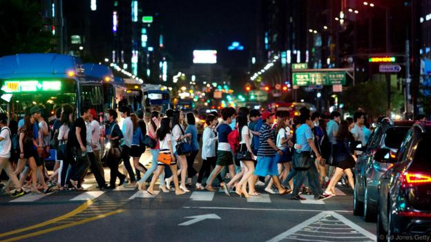 Seoul residents live a very fast-paced life (Credit: Ed Jones/Getty)