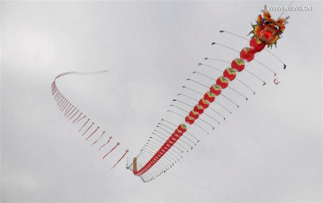 A 2016-meter long kite is seen during a kite fair in Qinzhou, south China's Guangxi Zhuang Autonomous Region, Dec. 3, 2016. Kites-flying fans from China and abroad took part in the fair on Saturday.