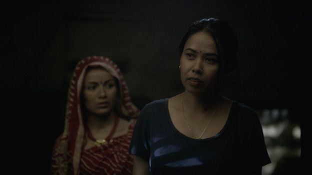 Chandra's estranged wife Durga (right), played by Asha Magarati