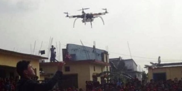 Students demonstrate remote controlled aeroplane in Tokha