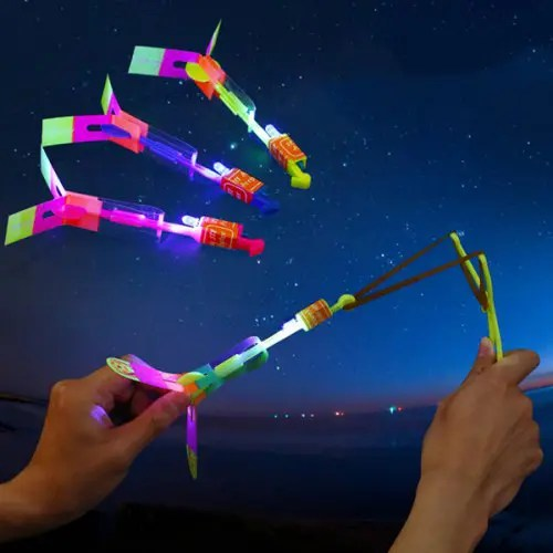 LED Light Helicopter Flying Toy Elastic Powered Sling Shot