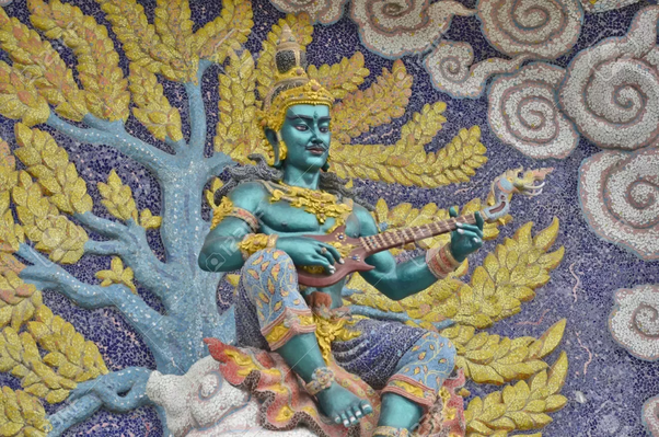 A representation of a Gandharva playing a string instrument