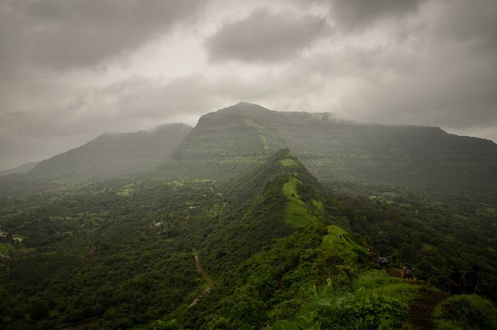 Tikona fort trekking in monsoon is an amazing experience. Read on to learn more about this spot in Incredible India.