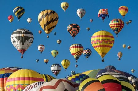 crowded with hot air balloons