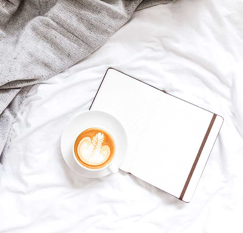 coffee and journal in the bed