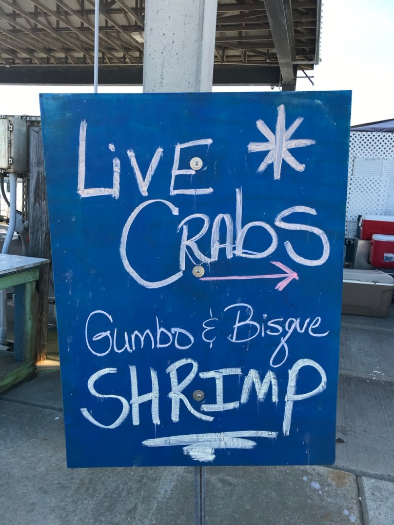 "Blue sign that says ""live crabs and shrimp"""