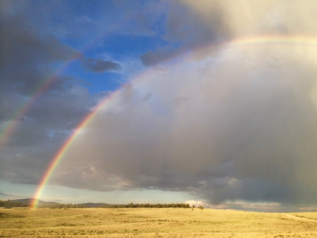 Double rainbow arcing across the Colorado sky.