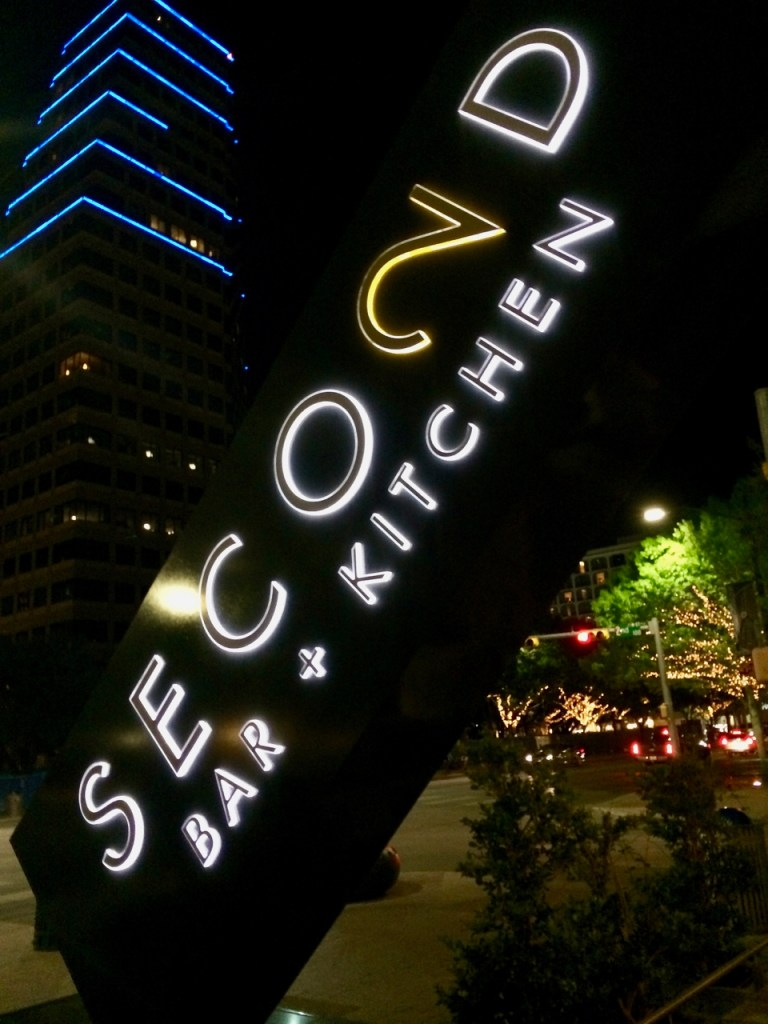 Second Bar + Kitchen Sign at Night in Austin, TX