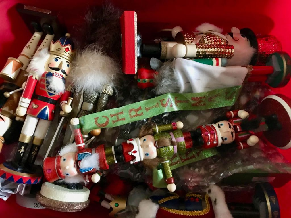 Nutcrackers in a red storage tub