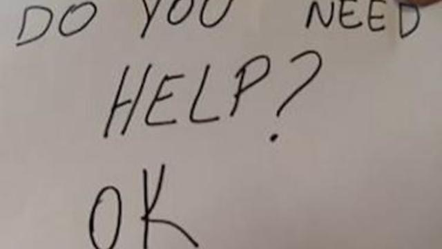 "Handwritten sign that says ""Do you need help?"""