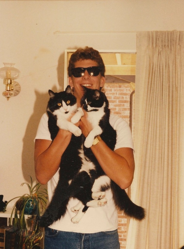 Steven Thomas Harvell in cheap sunglasses with cats