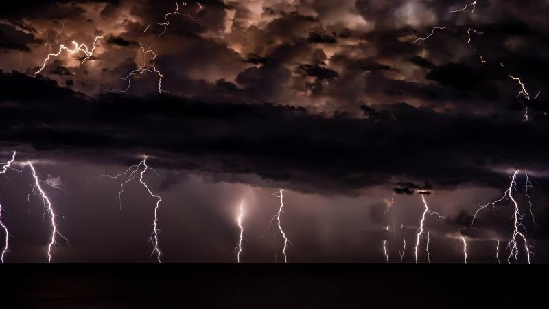Dark clouds with lightning reaching down