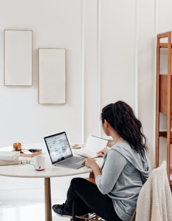 Woman working on Web Design on her laptop at home