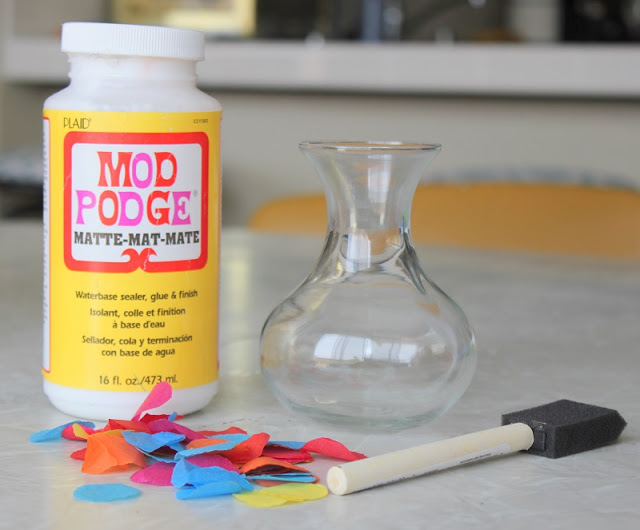 This technique can be used to decorate so many things and is an easy kids craft! Today we are going to make a vase. The mod podge makes the tissue paper water resistant. Just brush it over the glass, add the tissue paper circles and add another coat of mod podge.