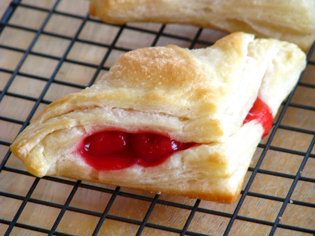 These homemade cherry turnovers are the real deal. They are made using an easy-to-follow puff pastry recipe. If you've ever been intimidated by making your own French puff pastry you'll definitely want to try these! The process takes a bit of time, but it isn't hard and your patience will reward you with buttery and flaky pastries that are to die for.