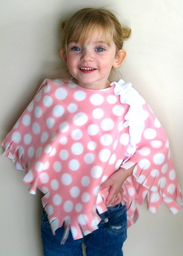Make a no-sew fleece poncho for a toddler! So cute and cozy for fall, it's like a blanket for their shoulders! I'll share this quick 10 minute project with an optional ruffle detail.