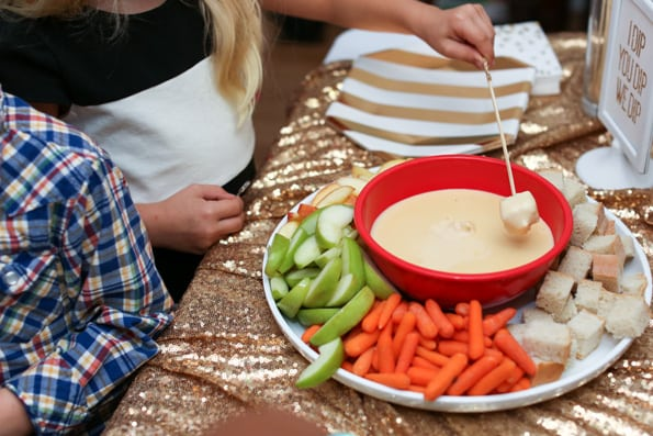 Ring in the new year with a fun New Year's Eve fondue party for kids! With delicious recipes for cheese and chocolate fondue and all of the fixins'!