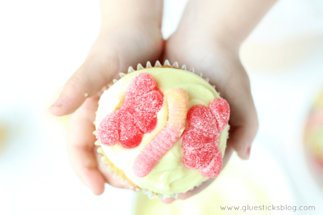 Making your own beautiful butterfly cupcakes is as easy as 1-2-3! Frost, add a gummy worm, then add two gummy candies for wings!