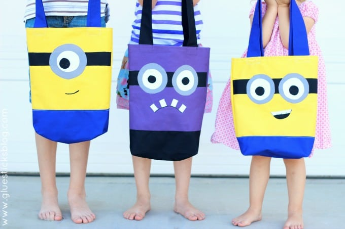 Make a DIY Minion Tote Bag that is perfectfor trips to the pool, a library tote, or even a preschool book bag. The kids drew pictures of their favorite Minion characters and I thought it would be fun to transform those guys into fun summer tote bags!