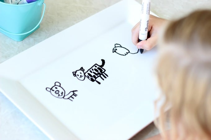 kids drawing on platter with oil based sharpie pens