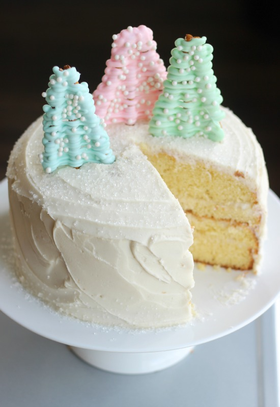 A deliciously moist vanilla cake filled with vanilla pudding sprinkled in sugar crystals and topped with white chocolate pretzel trees.