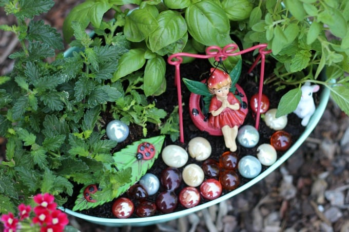A kitchen herb fairy garden is as practical as it is pretty! Trim the leaves of the herbs off to use in recipes and watch the flowers bloom. Such a fun way to brighten up the kitchen.