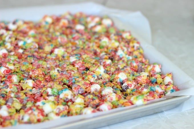 A chewy and spongy, Fruity Pebbles treats recipe made with cereal and marshmallows! Bright and colorful, perfect as an after school snack or for bake sales.