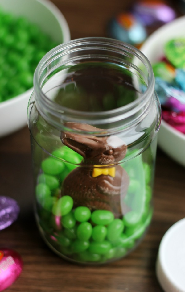 Easter Mason Jar Filled With Candy And A Chocolate Bunny