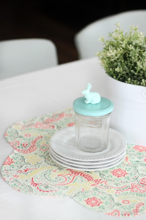 Add a pop of color to your table this spring with a DIY table runner! A quick and easy beginning sewing project. Use coordinating fabrics for a reversible runner!